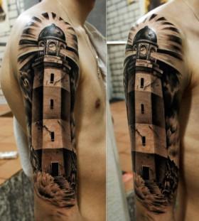 Amazing lighthouse arm tattoo