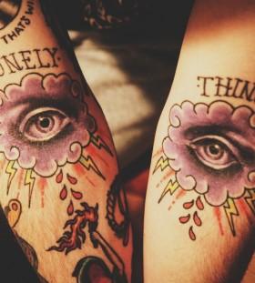 Amazing lightning and eye cloud tattoo