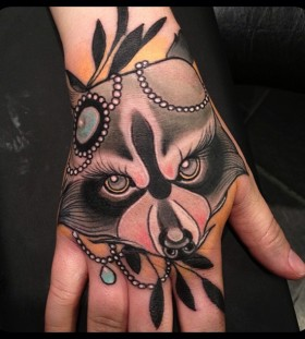 Amazing raccoon face hand tattoo