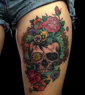 Amazing skull and flowers leg tattoo