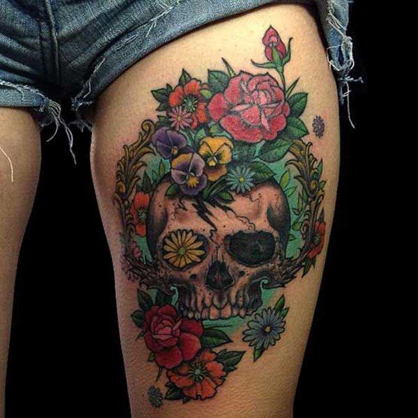 Amazing skull and flowers leg tattoo