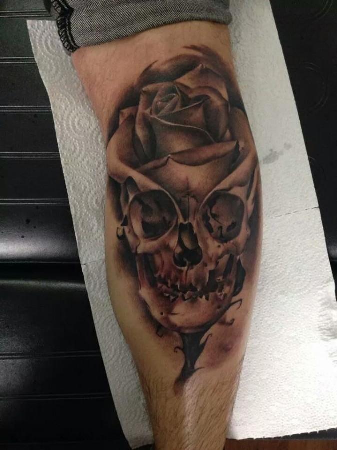 Amazing skull rose tattoo by Razvan Popescu