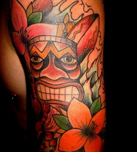 Amazing tiki arm tattoo