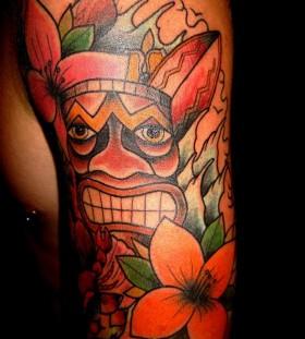 Amazing tiki arm tattoo