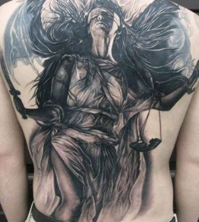 Amazing woman back tattoo by Elvin Yong