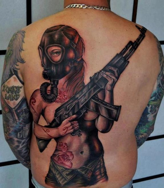 Amazing woman with gas mask back tattoo