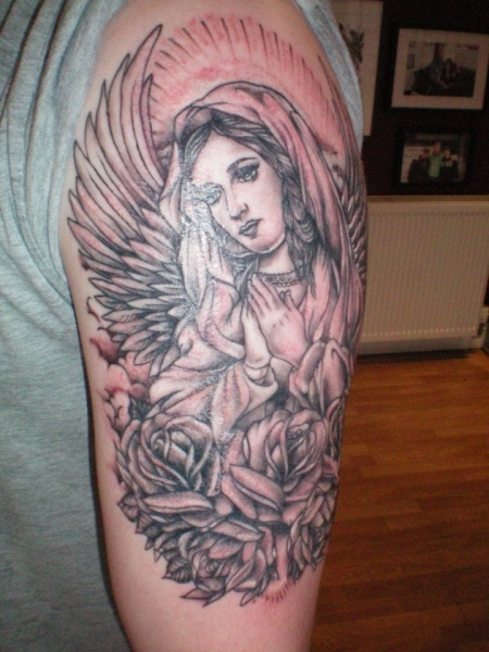 Angel and flowers tattoo by Flo Nuttall