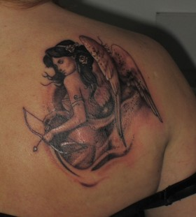 Angel with bow and arrow tattoo
