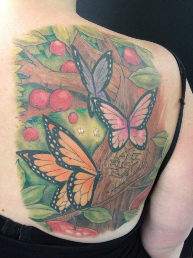 Apple tree and butterfly tattoo