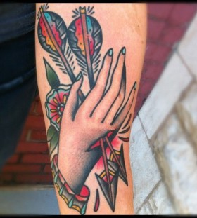 Arrows through hand tattoo by Nick Oaks