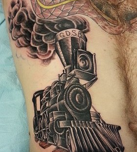Awesome black train tattoo