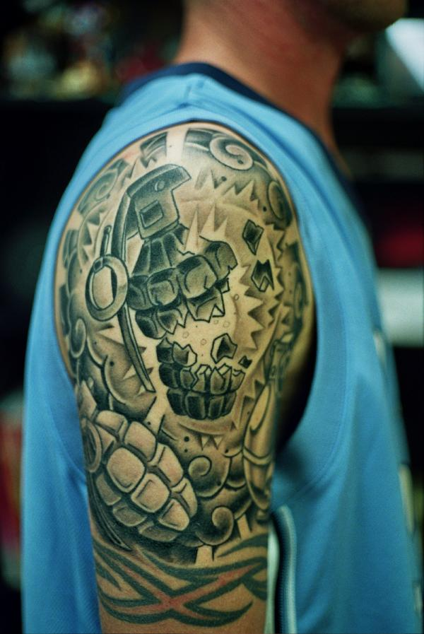 Awesome exploding grenade tattoo