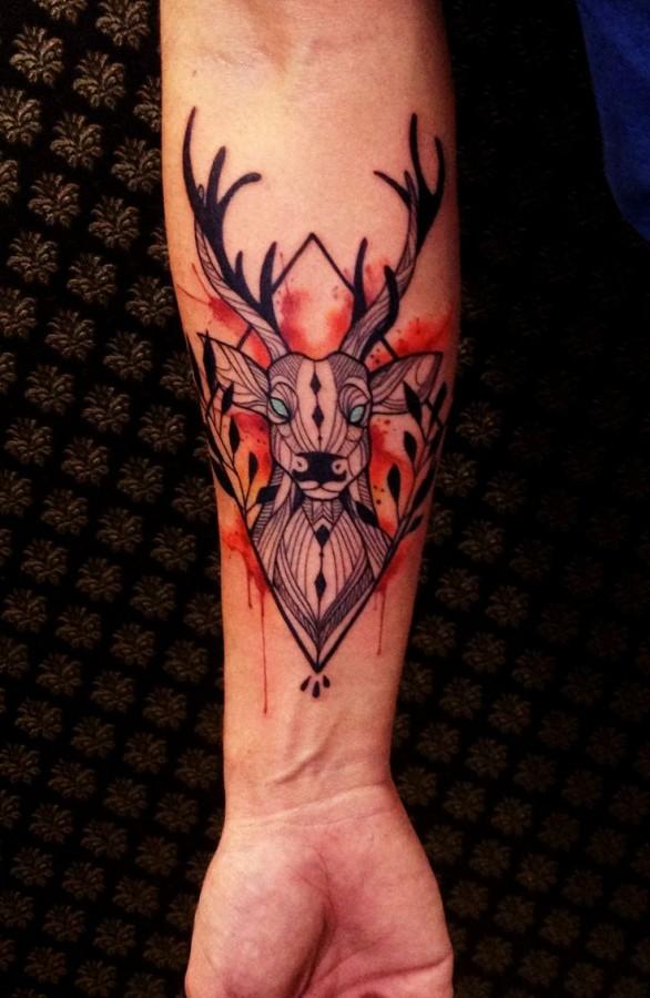 Awesome geometric deer tattoo by Tyago Compiani