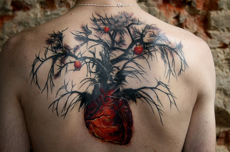 Awesome heart root apple tree tattoo