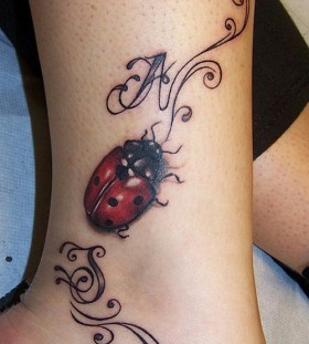 Awesome ladybug ankle tattoo