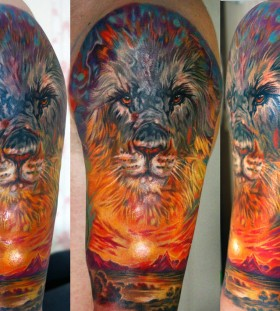 Awesome lion and sunset tattoo