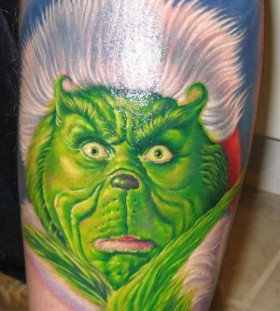 Awesome looking grinch christmas tattoo
