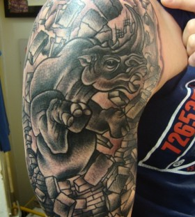 Awesome rhino arm tattoo