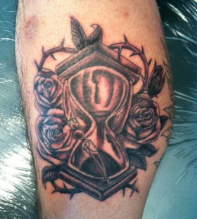 Awesome sand clock and roses tattoo