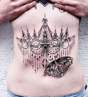 Awesome stomach tattoo design