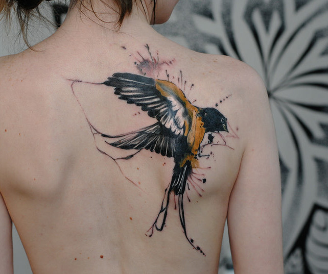 Awesome swallow back tattoo