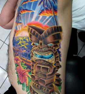 Awesome tiki and scenery tattoo