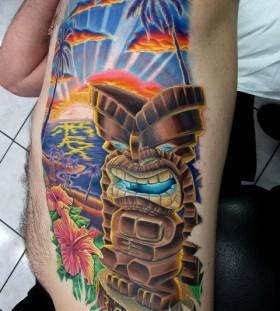 Awesome tiki and scenery tattoo