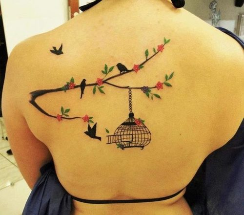 Awesome tree branch back tattoo