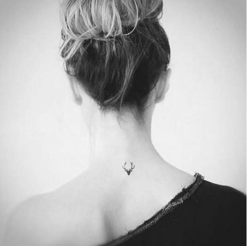Back small tiny tattoo