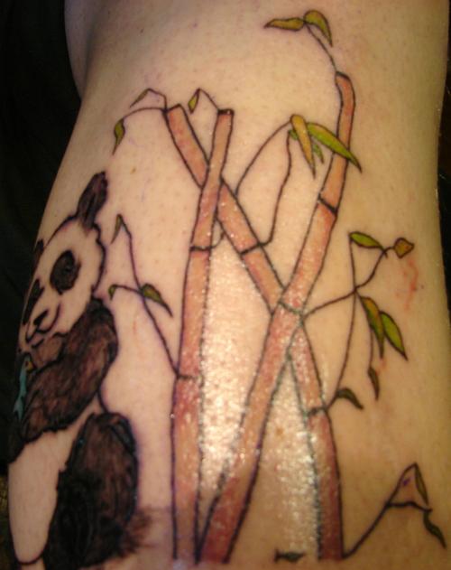 Bamboo and panda bear tattoo