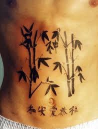 Bamboo and writing tattoo