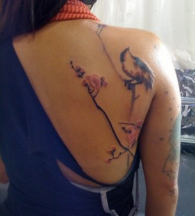Beautiful bird on a branch tattoo by David Allen