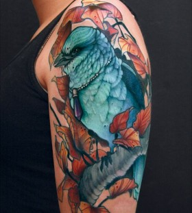 Beautiful blue bird arm tattoo