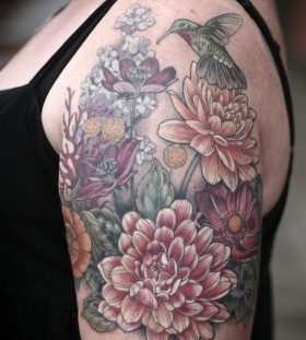 Beautiful flowers and bird tattoo by Alice Kendall