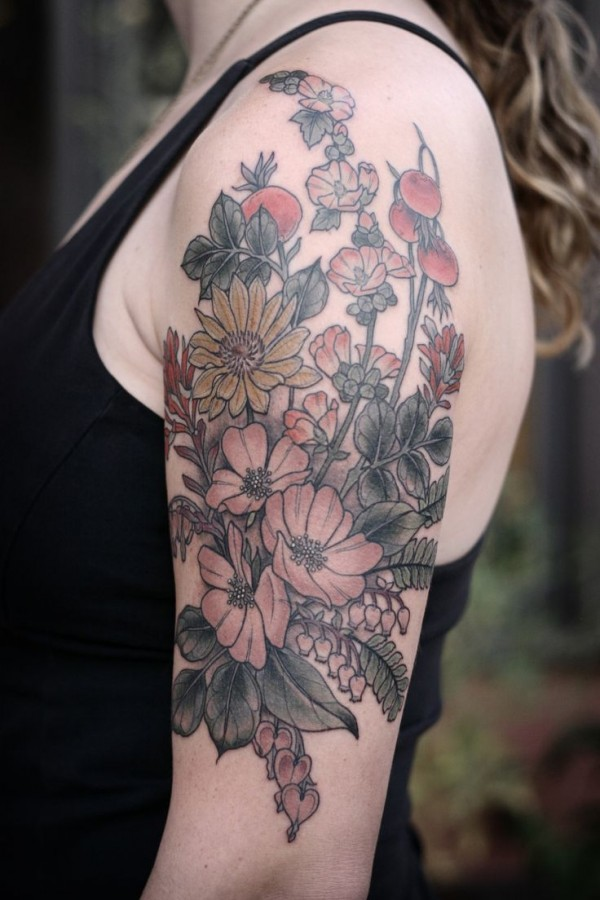 Beautiful flowers arm tattoo by Kirsten Holliday
