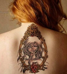 Beautiful girl frame back tattoo
