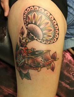 Beautiful gramophone leg tattoo