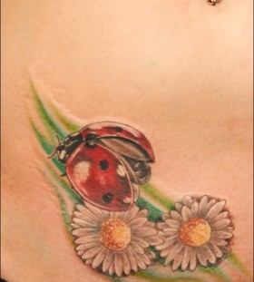 Beautiful ladybug and flower tattoo