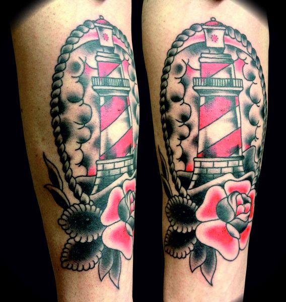 Beautiful lighthouse and rose tattoo