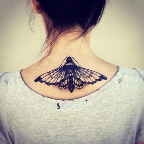 Beautiful moth back tattoo
