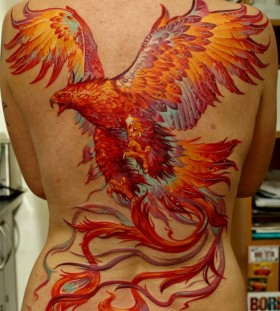 Beautiful phoenix back tattoo by Dmitriy Samohin