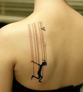 Beautiful puppet back tattoo