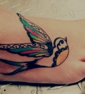 Beautiful swallow foot tattoo