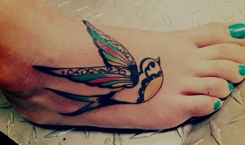 Beautiful swallow foot tattoo