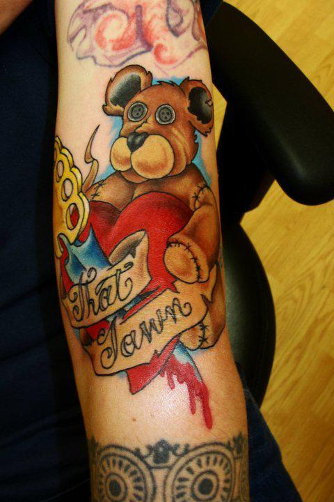 Beautiful teddy bear tattoo