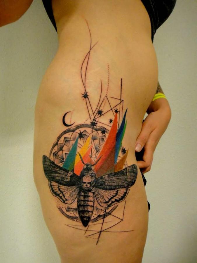 Beautiful thigh xoil tattoo