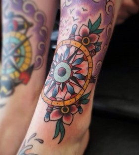 Beautiful wheel leg tattoo
