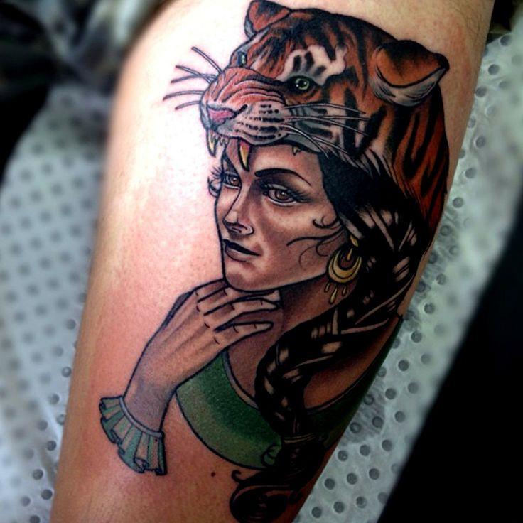 Beautiful woman with tiger's head tattoo by Drew Shallis