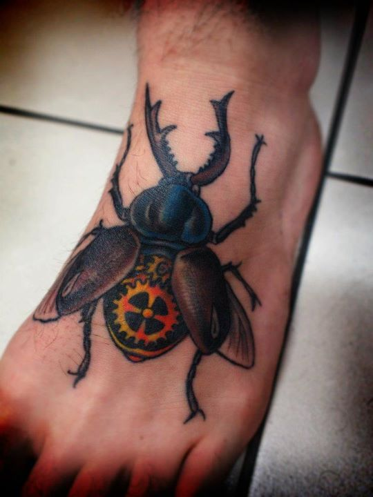 Beetle tattoo on foot by Charley Gerardin