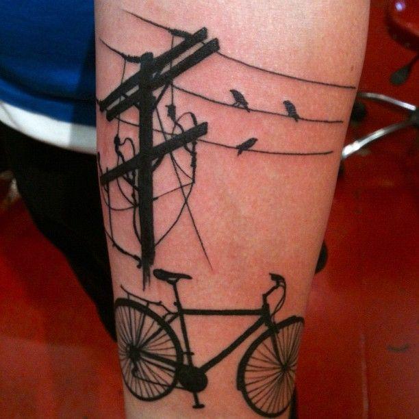 Bike, birds and black telephone tattoo